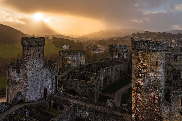 conwy castle rain storm photo north wales rainbow