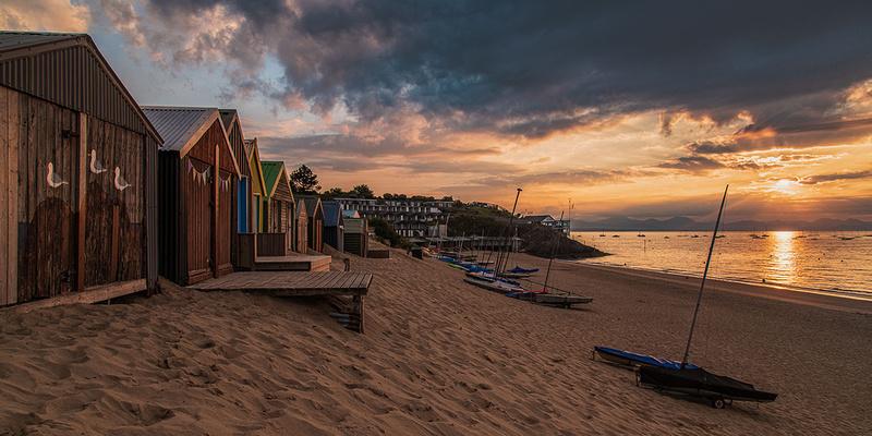 abersoch beach sunrise snowdonia mountains beach huts
