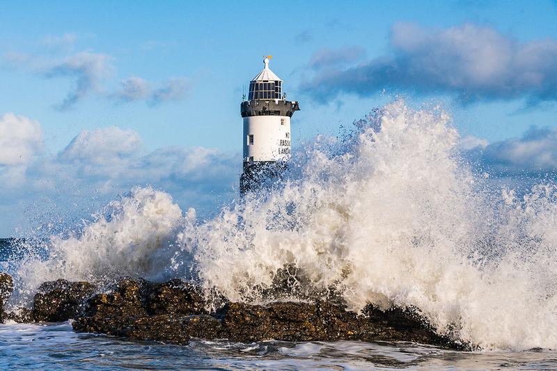 Penmon lighthouse and dramatic stormy seas