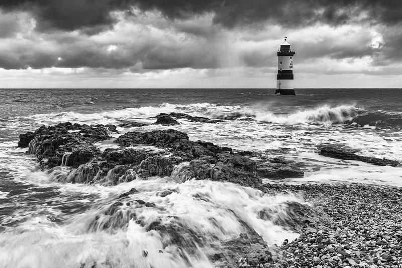 penmon lighthouse stormy seas black & white