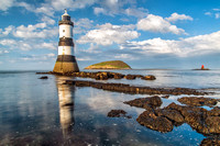 penmon lighthouse reflections spring sunshine anglesey north wales photos